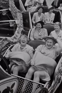 Women on coaster with multiple reactions